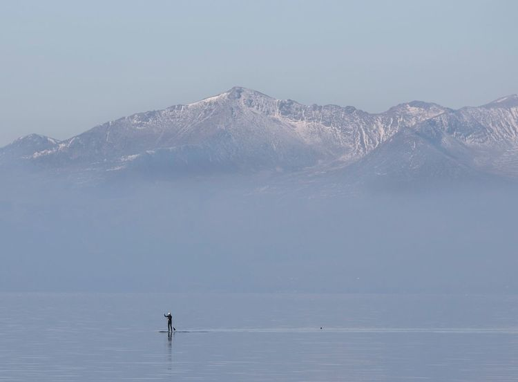 Springtime Scotland Outdoors Paddleboarding Paddle Nature Beauty In Nature Scenics Mountain View Snowcapped Mountain Calm Calmness Tranquility Seal Outdoor Activity Gillian McBain Photographer Adventure Clear Sky Water One Person Real People Flat Calm Snow Day Wetsuit