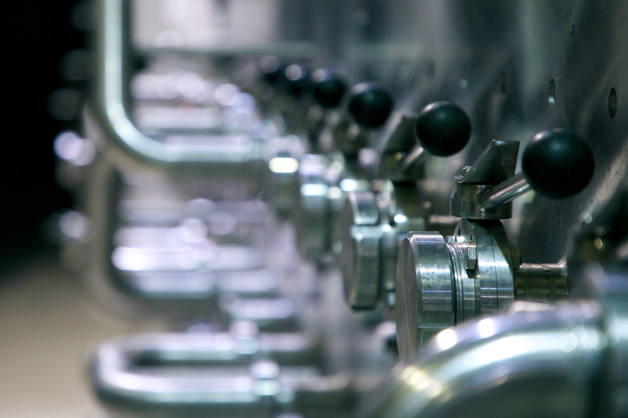 metal, close-up, indoors, selective focus, no people, machinery, stainless steel, steel, manufacturing equipment, day