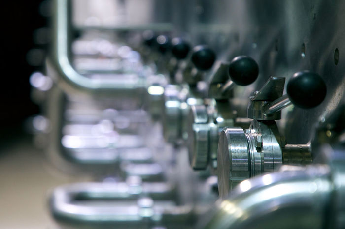 valves in a row Fluids High Pressure Inanimate Industry Objects Beauty Close-up Cold Temperature Electric Light Factory In A Row Indoors  Machinery Manufacturing Equipment Metal Metallic No People Selective Focus Stainless Steel  Steel