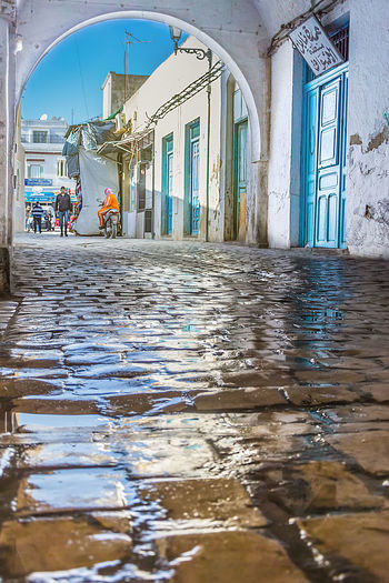 Old city in Nabeul Tunisia Arch Architecture City Day Nabeul Old City Old Way People Reflection Tunisia Walking People Water EyeEmNewHere EyeEmNewHere.