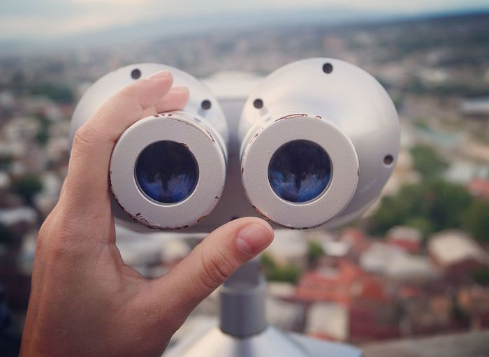 Cropped Hand Holding Coin-Operated Binoculars