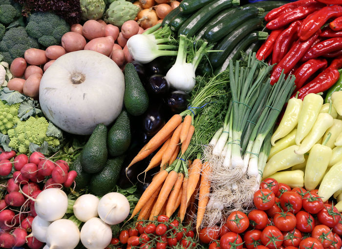 High angle view of tomatoes and vegetables in market