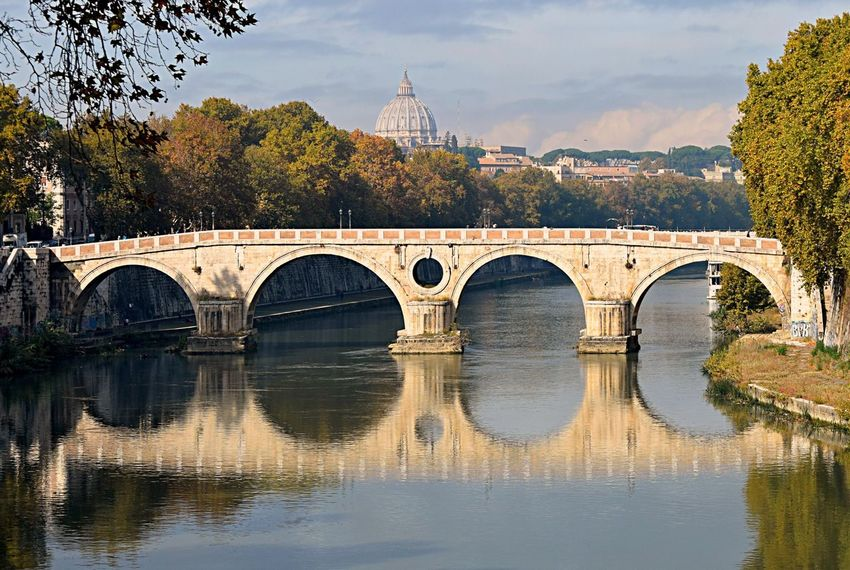"Ponte Principe Amedeo di savola, Roma. Apologies for my absence my friends, Had some ""Issues"" with my EE account and have been away in Italy. Moving Around Rome EyeEm Best Shots EyeEm Gallery EyeEmBestPics From My Point Of View Life's Simple Pleasures... My Unique Style Reflection Rome Taking Pictures Water Reflections Arch Bridge Architecture Bridge - Man Made Structure Built Structure Eye4photography  Getting Inspired Reflection_collection River St Peters Basilica"