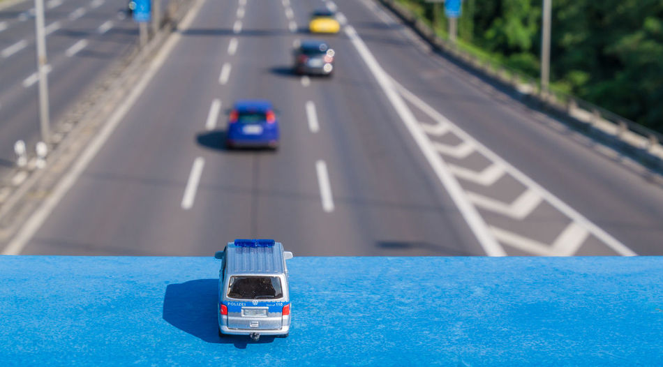 Business Stories Autobahn Blue Car City Day Focus On Foreground Land Vehicle No People Outdoors Police Road Speed Street Transportation Discover Berlin The Creative - 2018 EyeEm Awards