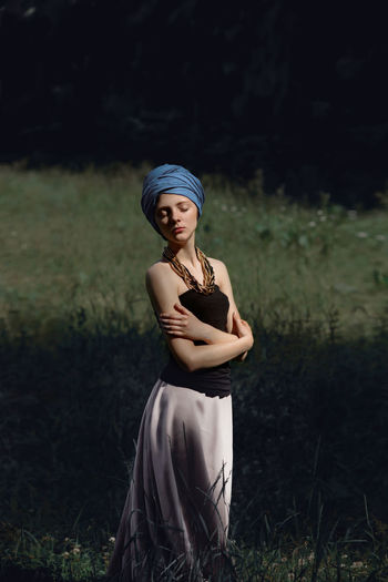 Young woman standing in grass