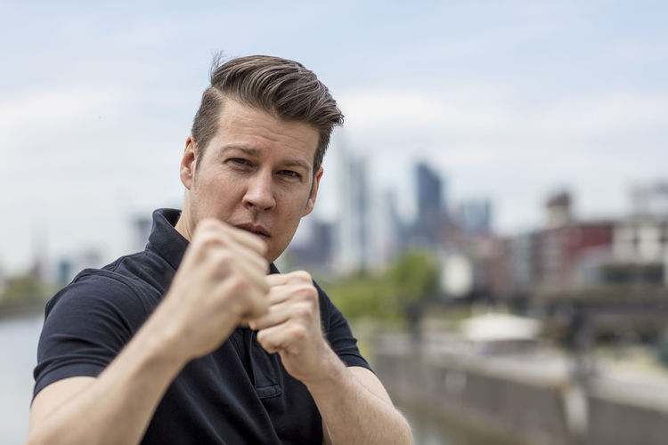 Portrait of young man in fighting stance