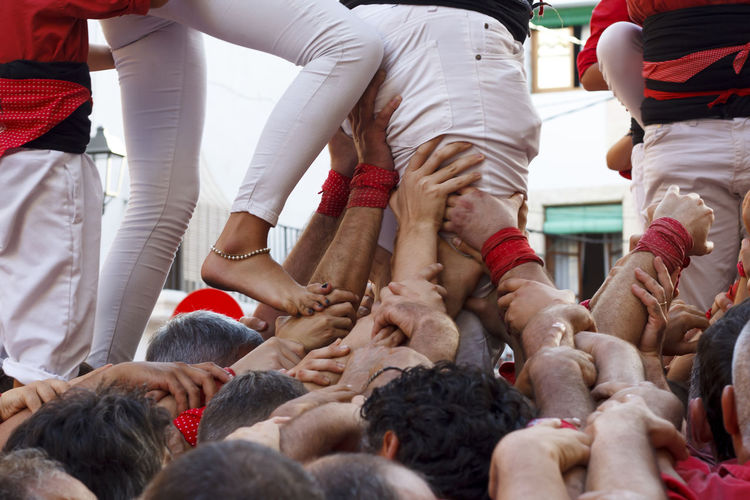 Low angle view of people performing during event