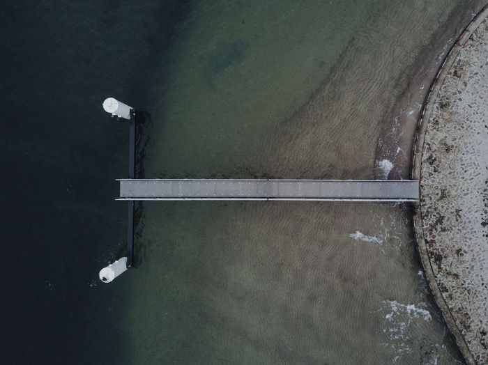 Arial of a small pier No People High Angle View Metal Day Outdoors Wall - Building Feature Street Directly Above Water Technology Transportation Wall Architecture Sport Built Structure Nature Road Absence Empty Arial Shot Pier Marine Baltic Sea Ocean