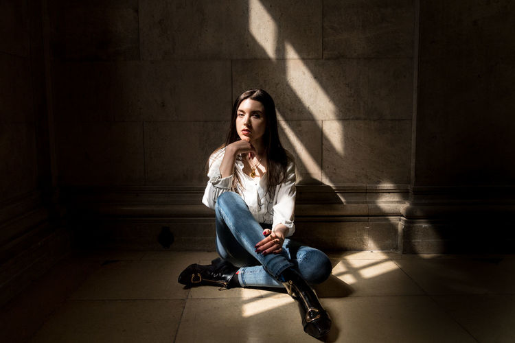 The Fashion Photographer - 2018 EyeEm Awards The Portraitist - 2018 EyeEm Awards Beautiful Woman Casual Clothing Contemplation Front View Full Length Hairstyle Indoors  Jeans Long Hair Looking At Camera One Person Portrait Shadow Sitting Sunlight Teenager Young Adult Young Women
