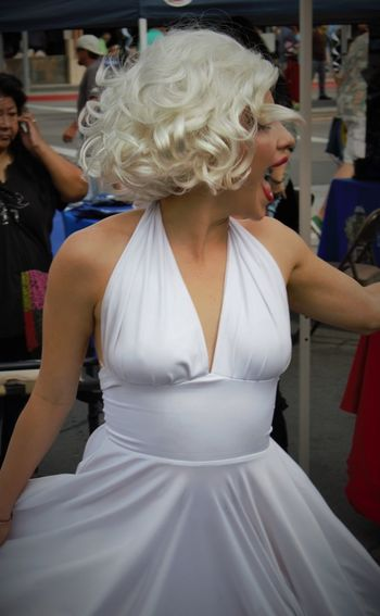A young woman in a Marilyn Monroe costume at the Palm Desert Golf Cart Parade Costume Fun Golf Cart Parade Halloween Palm Desert, CA Twirling White Dress Young Woman