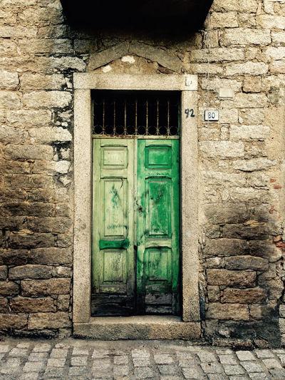 The green door Architecture Brick Wall Building Exterior Built Structure Closed Closed Door Door Entrance Façade Front Door Green Color House No People Outdoors Steps Stone Material