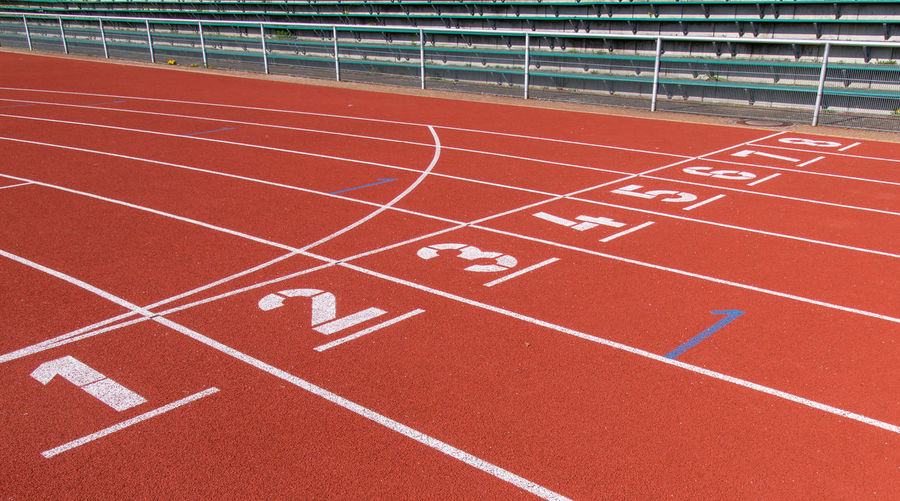 Lines Teamwork Team Sport Objectives Targets Running Orange Color Number Numbers Finish Line  Starting Line Start Track And Field Sport Running Track No People Red Sports Track Empty Absence Competition Day Stadium Outdoors Single Line Curve In A Row Striped Communication White Color Diminishing Perspective