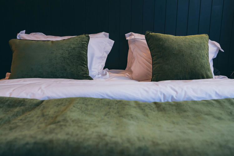Pillows and blanket on bed at home