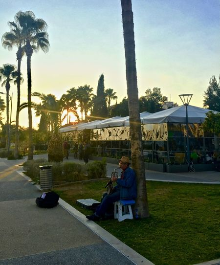 #busker #busking #jazz #sunset #sun #clouds #skylovers #sky #nature #beautifulinnature #naturalbeauty #photography #landscape Full Length One Man Only Outdoors Palm Trees Relaxation