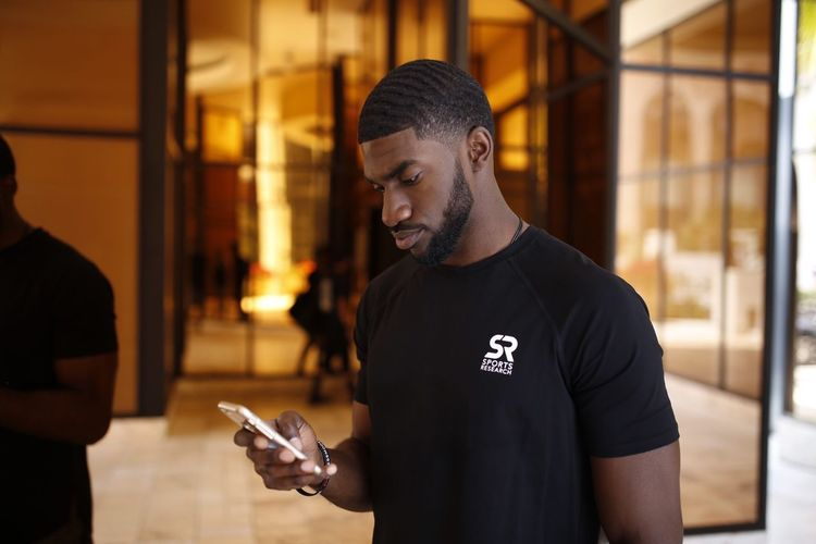 EyeEm Selects Communication Wireless Technology Real People Young Men Technology Focus On Foreground Smart Phone Using Phone Waist Up Beard One Person Young Adult Holding Men Telephone Portable Information Device Mobile Phone Casual Clothing Text Messaging
