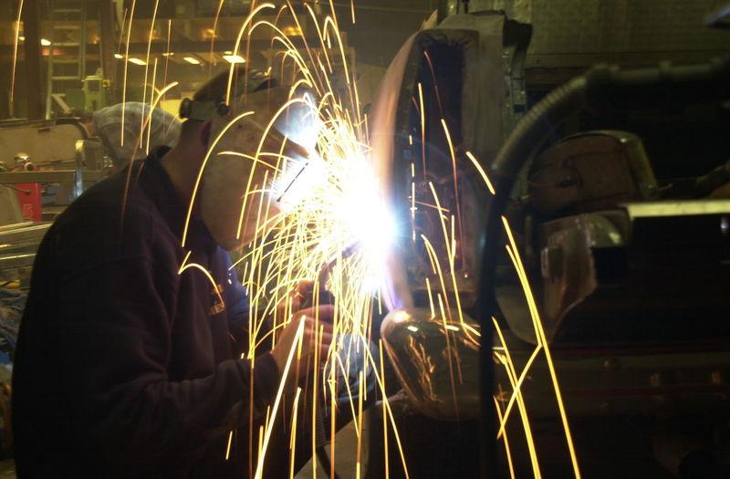 Welder Using Welding Torch In Factory