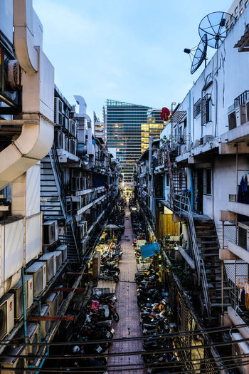 Bangkok, Thailand - May 13, 2017 : Small alley way with many motorcycles parking and a building at the end of alley at siam square Bangkok Cityscape Downtown Alleyway Architecture Bike Building Building Exterior Built Structure City Close-up Day Design Evening Landmark Motorcycles Outdoor Outdoors Siam Sky Street Streetphotography Style Walkway