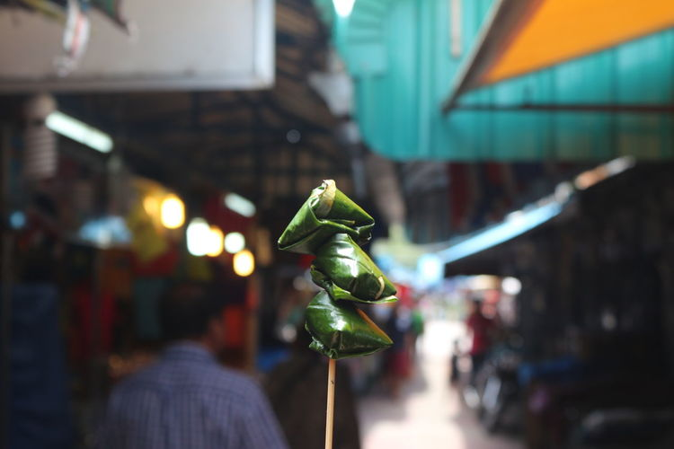 Close-up of paan against crowd at market
