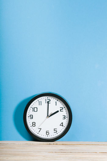 Man Blue Boy Clock Clock Face Close-up Copy Space Indoors  Instrument Of Time Male Minute Hand No People Number Single Object Still Life Studio Shot Table Time Wall - Building Feature Wall Clock Wood - Material