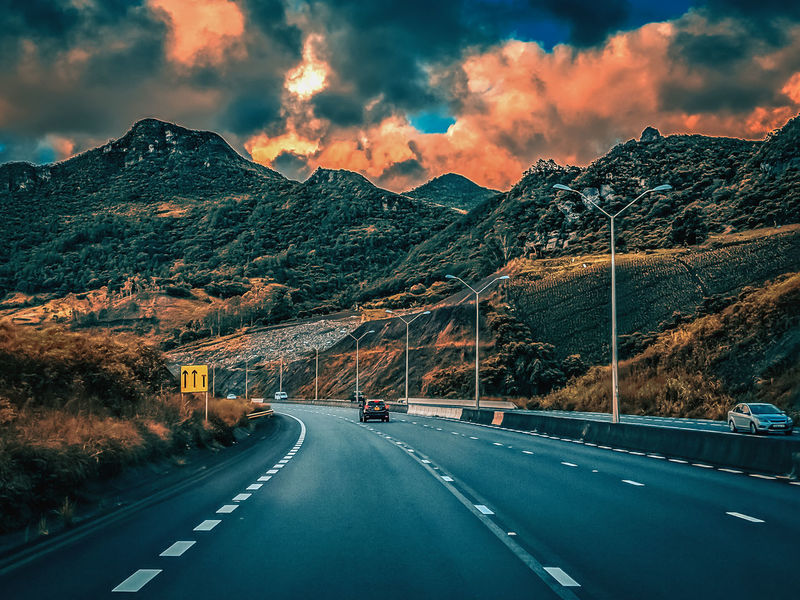 Ride Through The Mountains Path Destination Tourism Hill View Valley Goldenhour Leading Travel Mountain Road Highway Car Transportation Mountain Range The Way Forward Cloud - Sky Outdoors Land Vehicle Landscape Road Trip Sky Nature City