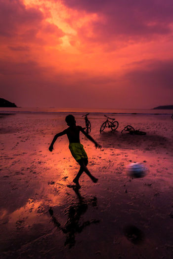 Football Silhouette Balance Beach Beauty In Nature Cloud - Sky Day Full Length Horizon Over Water Leisure Activity Nature One Person Orange Color Outdoors People Real People Sand Scenics Sea Silhouette Skill  Sky Soccer Sunset Water