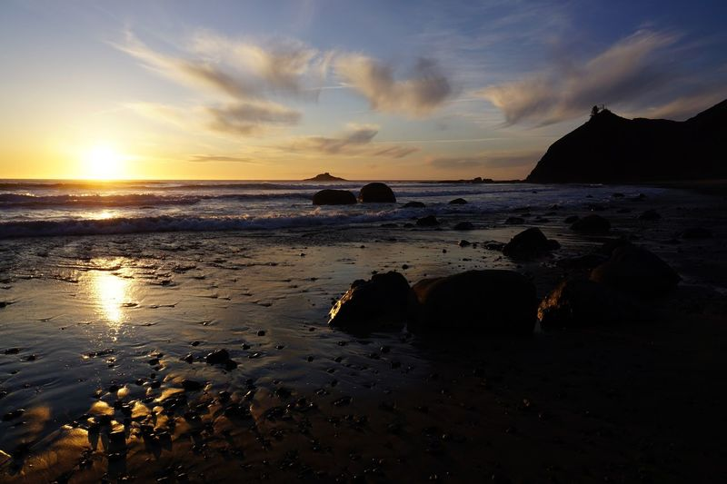 Waning daylight at Roads End, Oregon coast. Water Sea Sky Beach Sunset Land Scenics - Nature Beauty In Nature Horizon Over Water Tranquil Scene Horizon Rock - Object Silhouette No People Nature Tranquility Rock Cloud - Sky Idyllic
