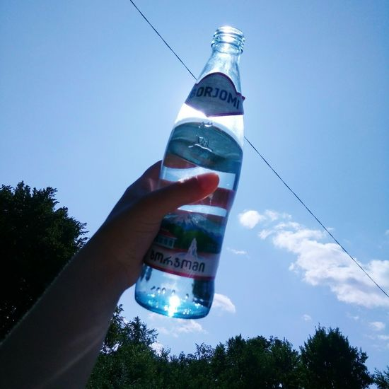 Borjomi Goodwater Healthy Lifestyle Human Hand Human Body Part Sky One Person People Cloud - Sky Outdoors