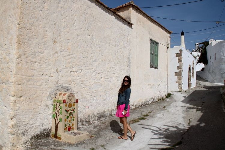 Architecture Beautiful Woman Building Exterior Built Structure Full Length Greece Street Lachania One Person Portrait Rhodes Ródos Standing Street Street Photography Tourist Travel Destinations Walking Around Young Adult Young Women Architecture Women Standing Building Wall - Building Feature Outdoors Adult Nature