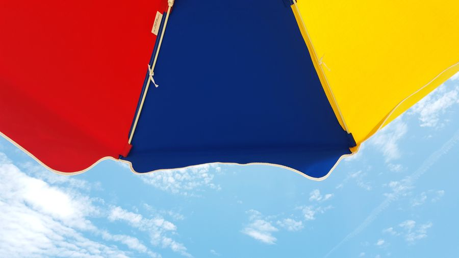 beach umbrella Beach Beach Umbrella Blue Close-up Cloud Colorful Colors Fine Art Photography Idyllic Low Angle View Multi Colored Nature Outdoors Part Of Primary Colors Red Scenics Sky Summer Tranquil Scene Tranquility Umbrella Vibrant Weather Yellow Lieblingsteil Sommergefühle Paint The Town Yellow