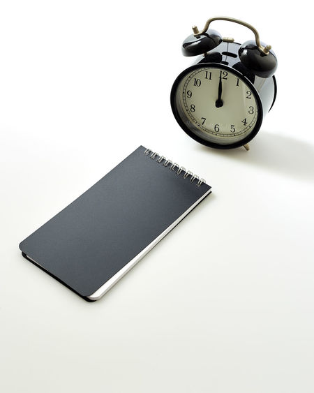 Black alarm clock with blank white notebook on white background, concept back to school School Notebook Business Workplace Office Object Clock Alarm White Space Background View Top Blank Desk Copy Table Empty Pencil Design Paper NotePad Work Time Pen Note Concept Flat Lay Book Wooden Black Education Computer Sport Laptop Keyboard Digital Retro Weight White Background Studio Shot Copy Space Indoors  Still Life No People Close-up Instrument Of Time Number Cut Out High Angle View Accuracy Single Object Watch Publication Black Color Communication Minute Hand Clock Face Personal Accessory