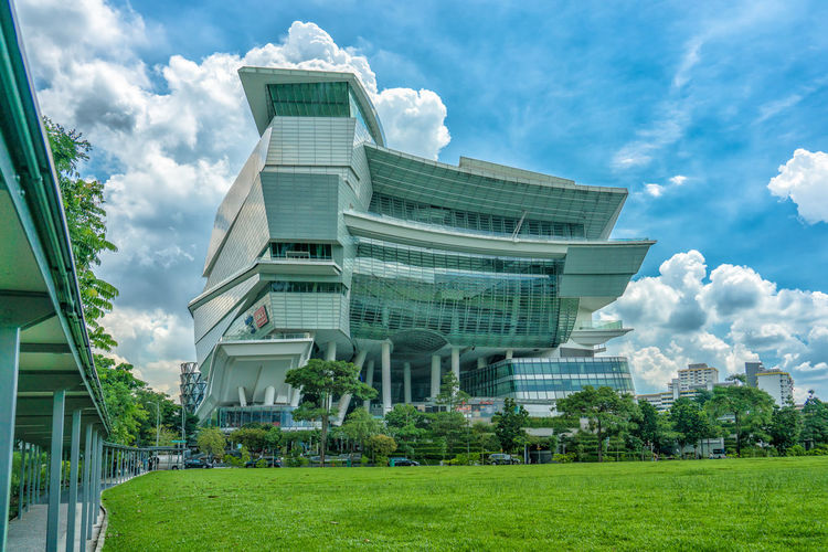 Singapore - May 25, 2018: The Star Vista in Singapore, amazing Architecture . Buona Vista Singapore The Star Vista The Architect - 2018 EyeEm Awards Architecture Building Building Exterior Built Structure City Cloud - Sky Day Grass Growth Low Angle View Modern Nature Outdoors Plant Sky Travel Destinations Tree