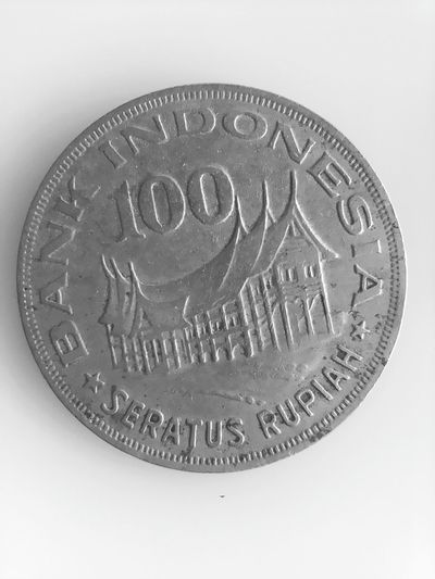 100 Indonesian rupiah in 1978 INDONESIA Years Coins Rupiah 1978 Shope Money Coin Savings Currency Finance Wealth Text Certificate Close-up Capital Letter Engraved Image Engraved Image Money Handwriting  Written Information Western Script Arrow Sign Note Directional Sign Board Single Word Silver - Metal Silver