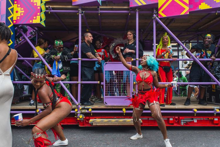 Notting hill carnival Notting Hill Carnival Photojournalism Adult Amusement Park Arts Culture And Entertainment Crowd Dancing Documentary Enjoyment Full Length Group Group Of People Leisure Activity Lifestyles Men People Performance Real People Skill  Women Young Women