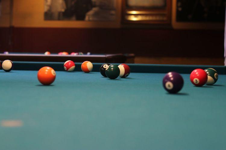 Colorful balls on pool table