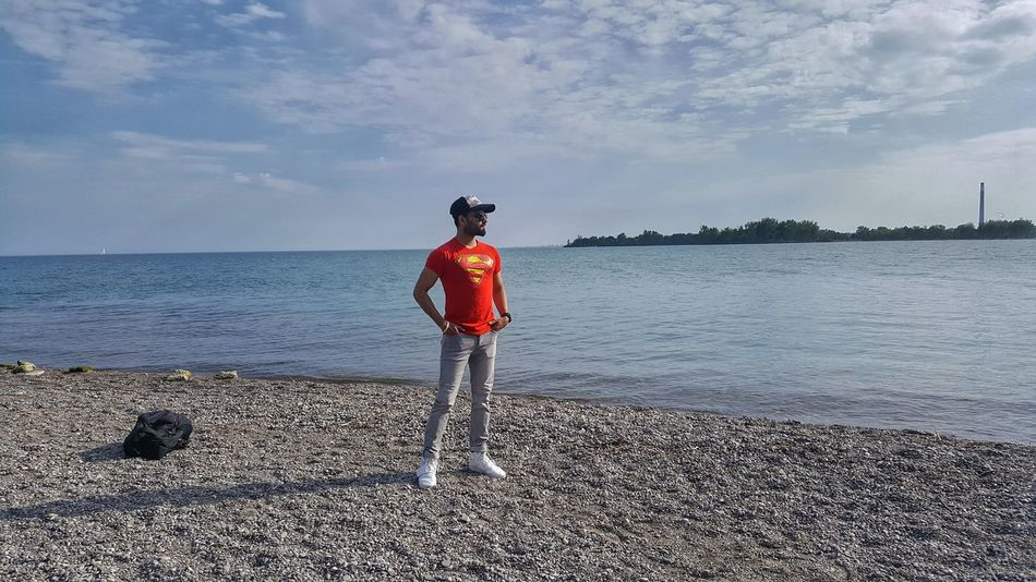 The gorgeous Woodbine beach! One Person Water One Man Only Full Length Sea Adult Sports Clothing Adults Only Only Men Cloud - Sky Standing Rear View Beach Sky People Outdoors Day Red Nature Headwear