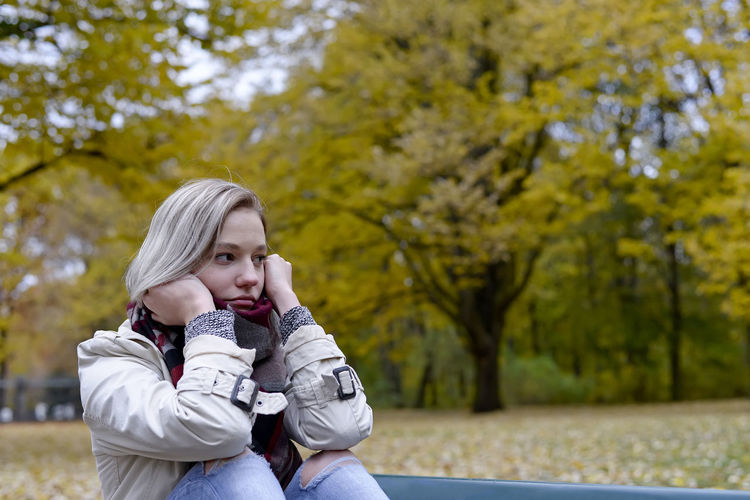 lonely young woman Autumn Bench Burnout Grief Loneliness Lonely Meditation Sitting Waiting Woman Depression Depressive Disappointed Dreamy Dreariness Girl Hopelessly Nostalgic Lovesickness Melancholy Millennials Sad Separation Teenager Thoughtfull Young Women
