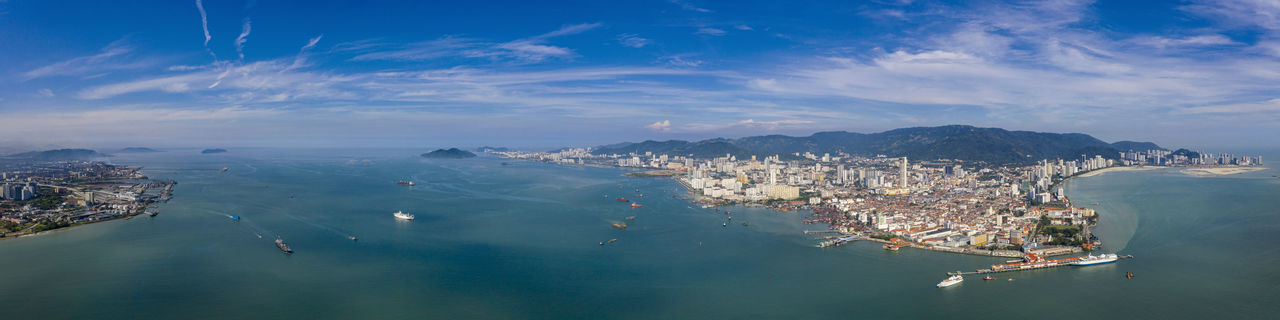 High angle view of sea and cityscape against sky