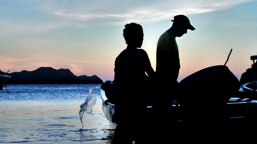 Taganga Taganga Colombia Beauty In Nature Cloud - Sky Fisherboy  Fisherman Leisure Activity Lifestyles Men Nature Outdoors People Real People Sea Silhouette Sky Sunset Togetherness Water