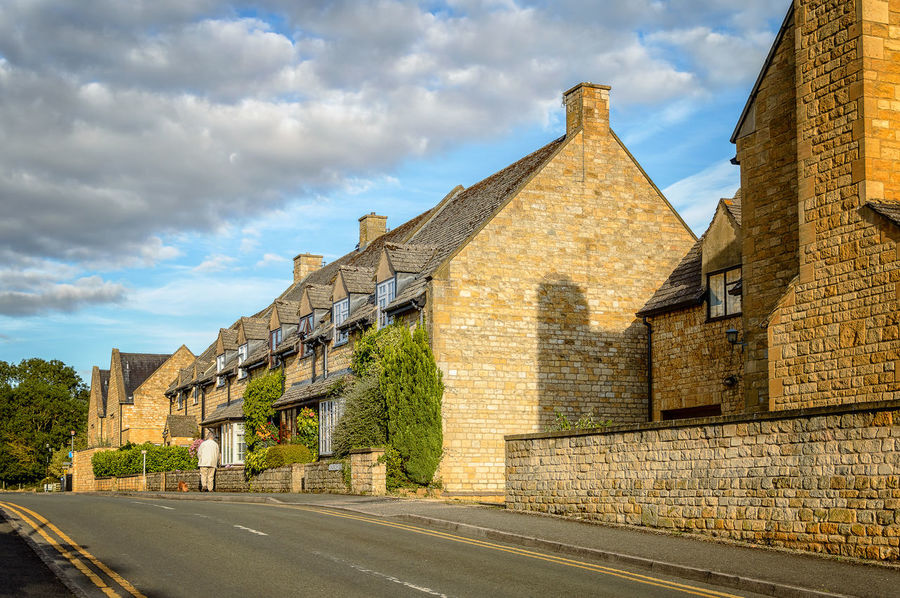 Empty street with typical limestone houses in Broadway, Cotswolds Architecture Architecture Broadway Building Exterior Built Structure Cloud Cloud - Sky Cloudy Colors Cotswolds Day Diminishing Perspective Empty Golden Hour Hanging Out Limes No People Outdoors Road Road Sky Sunny The Way Forward Vanishing Point