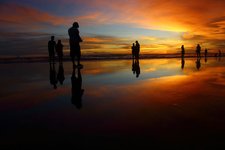 Twilight silhouette on Parangtritis beach Holiday Moments Parangtritis Yogyakarta, Indonesia Adventure Beach Beauty In Nature Beauty In Nature Group Of People Indonesia_photography Leisure Activity Lifestyles Nature Orange Color Outdoors Real People Reflection Scenics - Nature Sea Seascape Silhouette Sky Sunset Travel Destinations Water