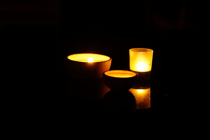 Tea lights / coffee table Flame Candle Glowing Illuminated Black Background Night