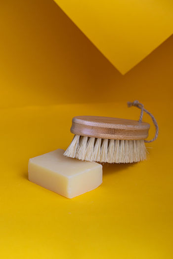 High angle view of soap and brush on table