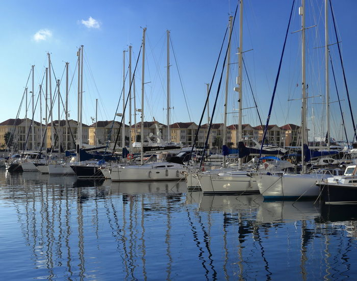 Boats moored in Queensway Marina in Gibraltar Gibraltar Landscape Gibraltar Views Moored Boats Architecture Blue Sky Building Exterior Day Gibraltar Harbor Marina Mast Mode Of Transport Moored Nautical Vessel No People Outdoors Reflection Sailboat Sea Sky Transportation Travel Destinations Water Waterfront Yacht