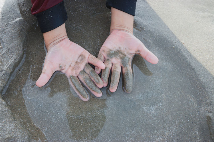 High angle view of hands on water