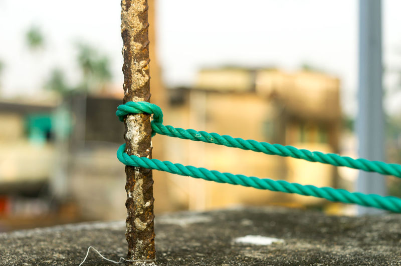 Close-up of rope tied to metal pole