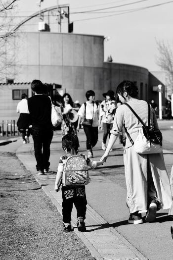 Building Exterior Full Length Outdoors Built Structure Girls Large Group Of People Day Real People Architecture City Men Childhood Lifestyles Boys Women Child Crowd People Adult Love ♥ Lovely So Warm Mom & Son Candid Photography Candid Moment