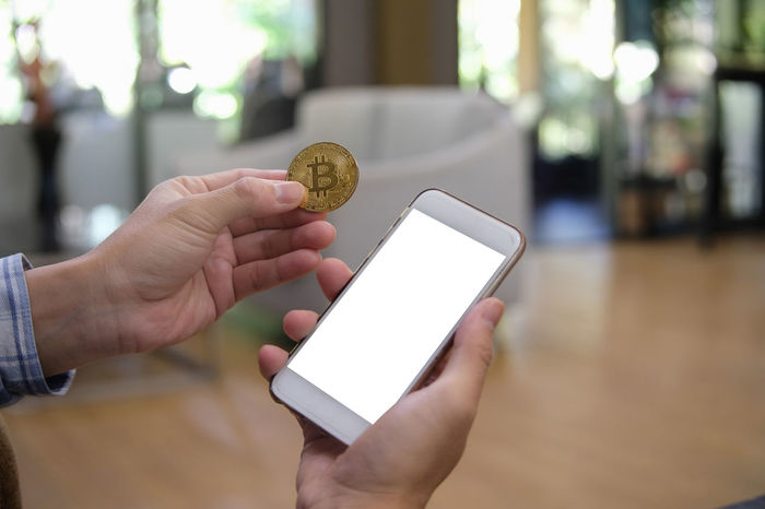 Cellphone Copy Space Electronic Hand Holding Screen Tread Banking Bitcoin Blurred Background Blurry Display Exchange Goden Internet Mining Mock Up Money Smartphone Trade White