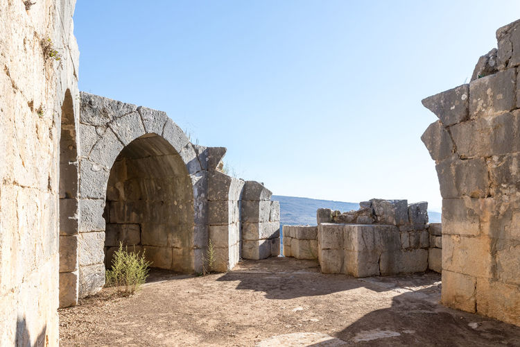 The inner part of the destroyed corner tower in Nimrod Fortress located in Upper Galilee in northern Israel on the border with Lebanon. Nimrod Fortress History Heritage Castle Fort Israel Saladin Beybars Crusaders Ayubids Mamluks Assassins Tower Travel Destinations Wall Stone Material National Park Tourism Hill Old Ancient Architecture Medieval Landmark Ruin Protection