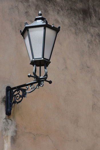 Low angle view of lamp mounted on wall
