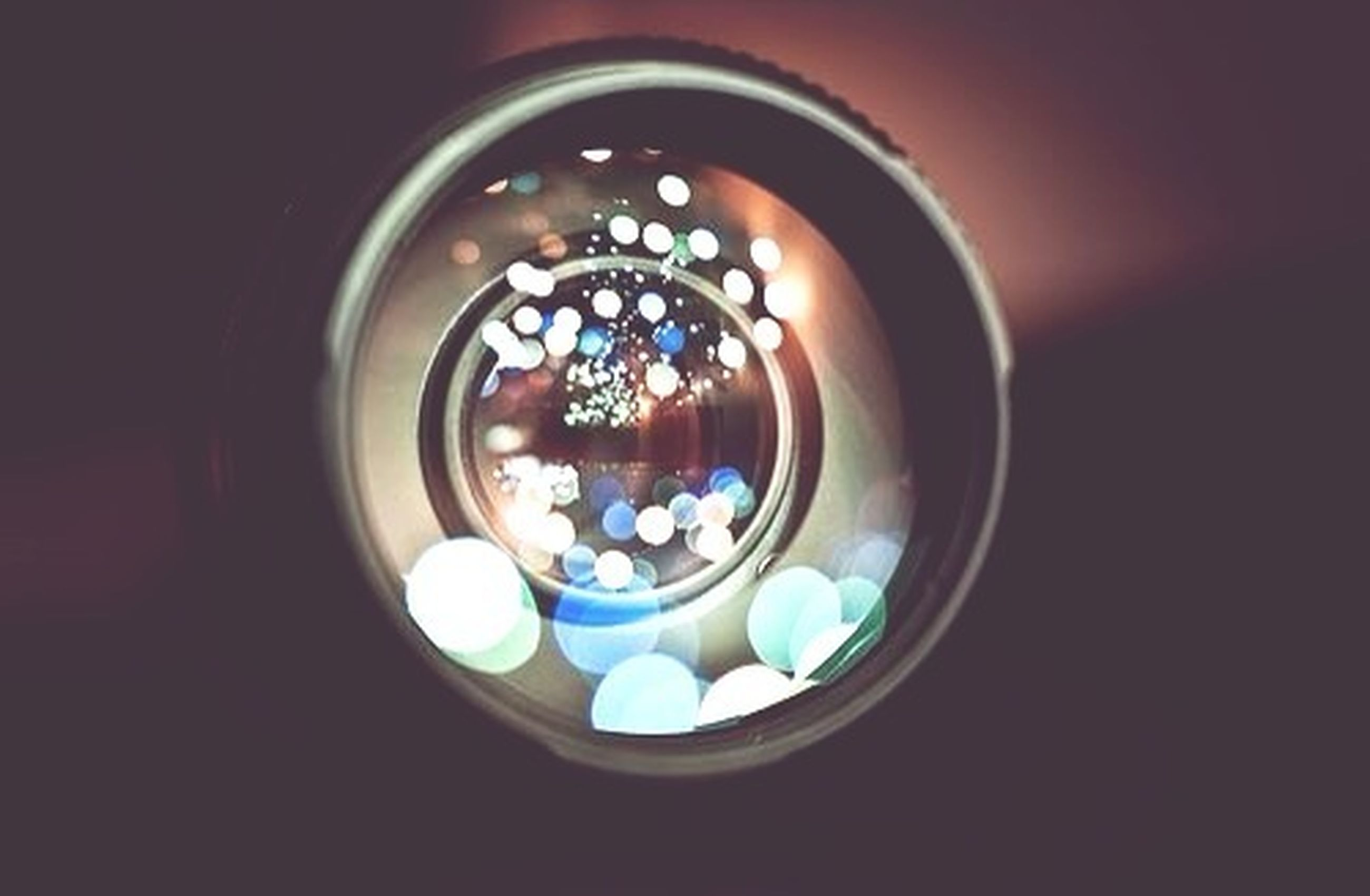 indoors, circle, glass - material, illuminated, multi colored, close-up, blue, transparent, reflection, geometric shape, no people, window, still life, high angle view, lighting equipment, decoration, table, pattern, shape, home interior